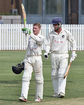 Nick King celebrates his century with partner James Billington